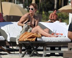 http://img281.imagevenue.com/loc188/th_311817777_Mischa_Barton_Bikini_Candids_on_the_Beach_in_Miami_December_27_2011_107_122_188lo.jpg